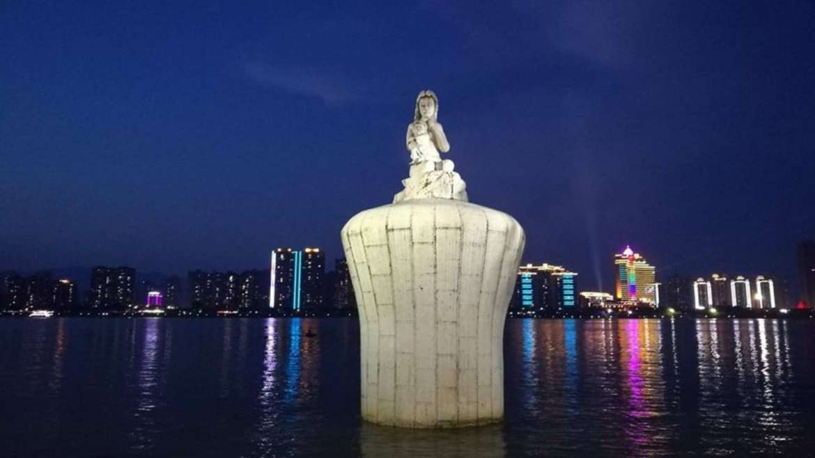 Jiangbin Park at evening, view of Beijiang River and its Mother's statue