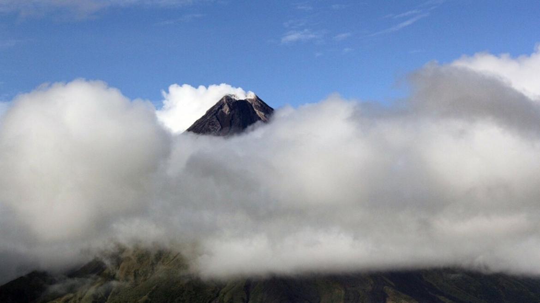 Mayon Volcano behind clouds