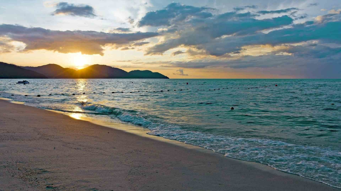 A beach on Penang Island at sunset