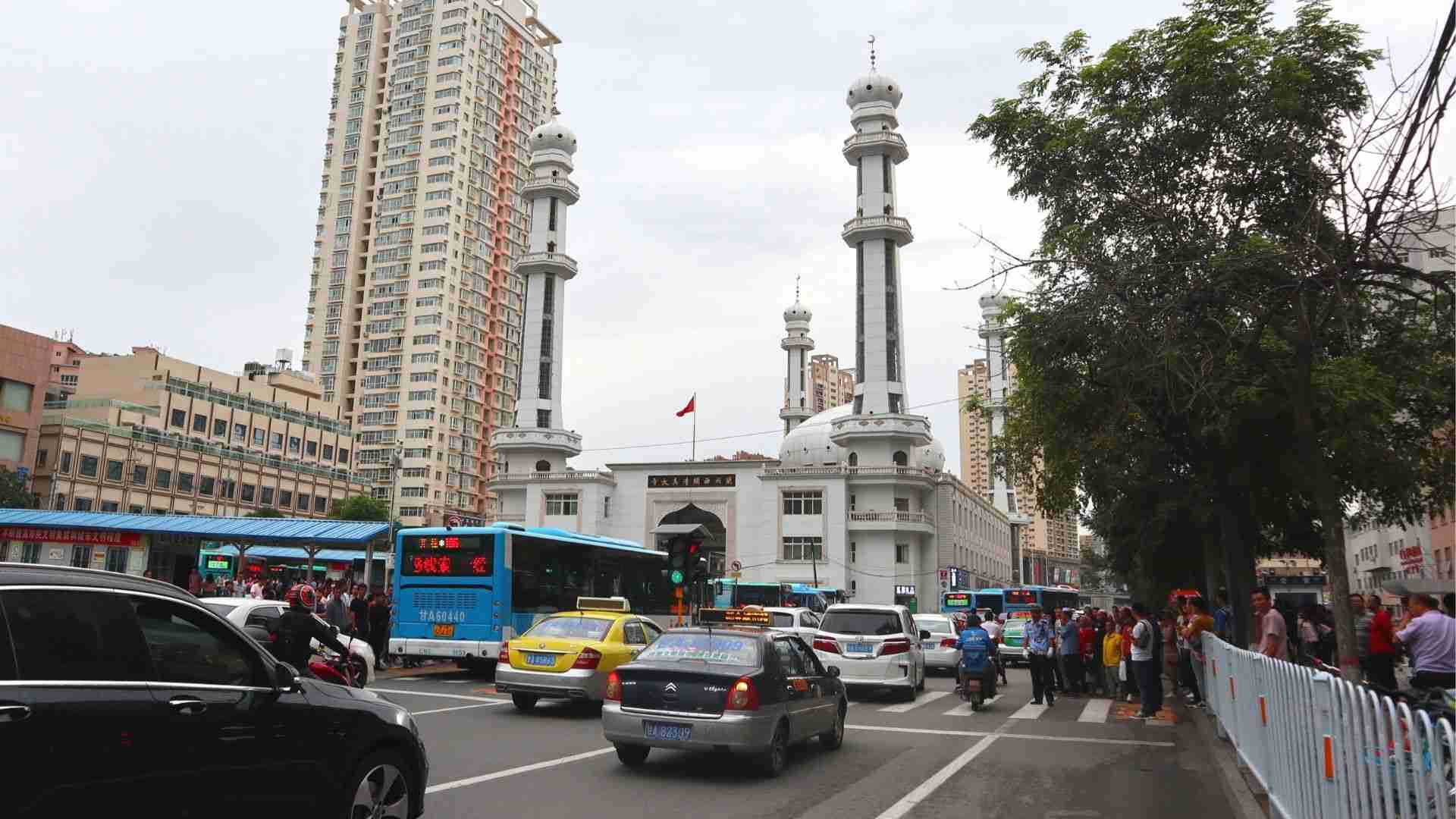 Street traffic in Lanzhou with Xiguan Mosque behind